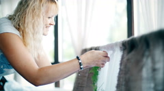 Designer at work: she draws flowers wedding arch Stock Footage