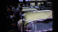 1962: gathering of people around a car after a wedding talking and waiting Stock Footage