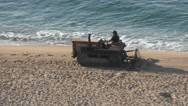 Tractor ranks the sand and cleans the beach Stock Footage