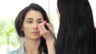Design of eyebrows girl in a beauty salon, eye shadow applied with a brush Stock Footage