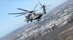 U.S. Marine helicopters combat a wildfire in San Diego County. Stock Footage