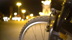 Cycling tour around big city at night, defocused traffic in illuminated street Stock Footage