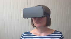 Handheld shot of woman with VR headset goggles Stock Footage