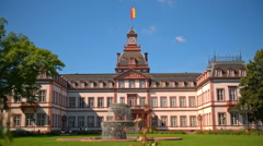 Beautiful old building with a fountain in Germany Stock Footage