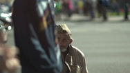Homeless guy on the street in the old army uniform Stock Footage
