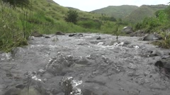 Beautiful Hills and River Water Flowing Towards the Camera Between Rocks Stock Footage