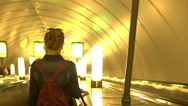 Pretty young girl descends to the city subway Stock Footage