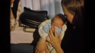 1967: women very happy to see born baby NEVADA Stock Footage