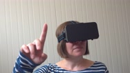 Handheld shot of woman with VR headset Stock Footage