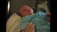 1967: wore a dress to the born baby looks so precious NEVADA Stock Footage