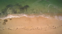 Aerial closeup - Hovering the seaside until a granite rock protrusion. Stock Footage