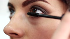 Mascara for the eyes, girl paints her eyes close-up Stock Footage