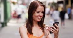 4k, Young attractive woman playing an online game on her mobile phone.  Stock Footage