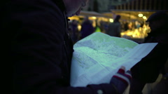 Confused man looking at paper map, checking route, direction to trip destination Stock Footage