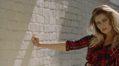 Sexy blonde model posing on brick wall background Stock Footage