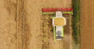 Aerial view of combine harvester Stock Footage