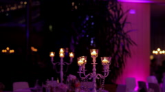 Candelabra with lighted candles in the evening in the hall Stock Footage