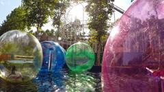 Little Girl Having fun Inside Walking Water Ball Stock Footage