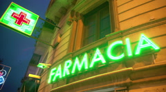 Farmacia LED sign on drugstore, retail store selling medication, pharmaceuticals Stock Footage