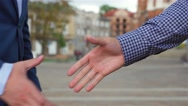 A handshake of two businessman. City background Stock Footage