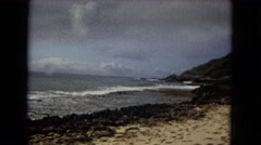 1967: scenic view of ocean, mountains, sky and sandy beaches, and the tide Stock Footage
