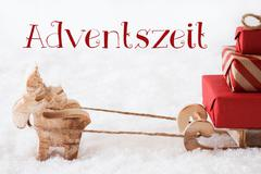 Reindeer With Sled On Snow, Adventszeit Means Advent Season Stock Photos