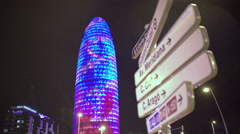 Torre Agbar office building sparkling with many colorful LED lights at night Stock Footage