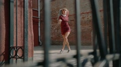 Sexy blonde model posing on the background of the fence Stock Footage