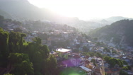 Aerial of the city of Rio de Janeiro from sunny Santa Teresa hills and slums Stock Footage