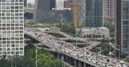 4k,timelapse,heavy traffic through BeiJing central business district,building. Stock Footage