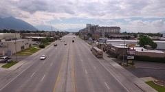 Aerial shot of a busy city and large street with cars Stock Footage