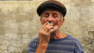 Footage a man at the age of smoking a cigarette. 120fps slow motion. HD Stock Footage