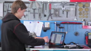 Mechanic takes hex key wrench from the table Stock Footage
