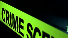 Slider Shot Of Police Crime Scene Tape With Hand Gun In The Background 2 Stock Footage
