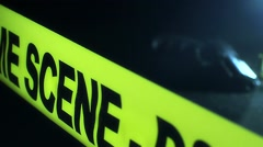 Slider Shot Of Crime Scene Tape With Hand Gun In The Background 1 Stock Footage