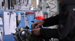 Mechanic takes clamp from the pegboard Stock Footage