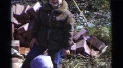1967: a group of small children and a cowboy playing outdoors in the fresh air Stock Footage