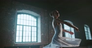 Beautiful girl ballerina performs pirouettes of classical ballet to the loft Stock Footage