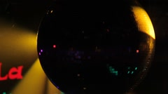 Disco ball spinning in the spotlight Stock Footage