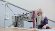 Seamstress puts the cloth into the sewing machine Stock Footage