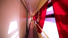 Interior of business class sleeping coach. Two cups of morning coffee on table Stock Footage
