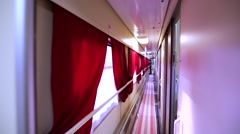 Walking through the corridor in russian railway business class sleeping coach Stock Footage