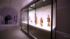 View of small statues of ancient asian gods. Hermitage museum, St. Petersburg Stock Footage