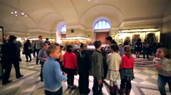 Children and guide are around the huge sarcophagus in Hermitage, St. Petersburg Stock Footage