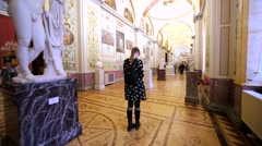Walking along the corridor with sculptures and pictures in Herminage Museum Stock Footage