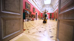 Interior of room with paintings and furniture in Hermitage Museum, St Petersburg Stock Footage