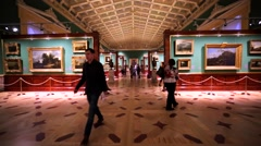 Show room with pictures and many tourists in Hermitage Museum, St Petersburg Stock Footage