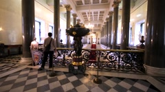 View of wide staircase with red carpet and marbled columns in Hermitage Museum Stock Footage