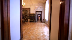 Walking through show rooms with old furniture in Hermitage Museum, St Petersburg Stock Footage