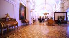Walking in hall with pictures and other items in Hermitage Museum, St Petersburg Stock Footage
